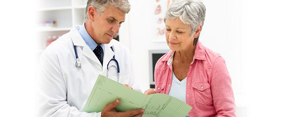 Doctor reviewing a chart with a patient